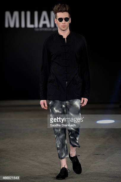 39472dfbce8ef0 A model walks the runway at the Milian by Annette Goertz show during  Platform Fashion Dusseldorf
