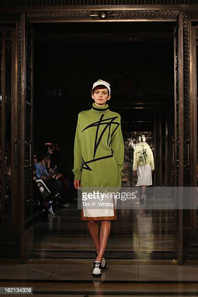 A model walks the runway at the Ming Pin Tien show during London Fashion Week Fall/Winter 2013/14 at Freemasons Hall on February 19 2013 in London...