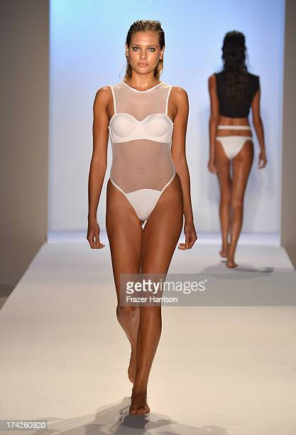 A model walks the runway at the Minimale Animale show during MercedesBenz Fashion Week Swim 2014 at Oasis at the Raleigh on July 22 2013 in Miami...
