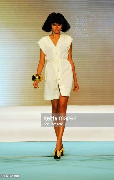 A model walks the runway at the Minimarket show at MercedesBenz Stockholm Fashion Week Spring/Summer 2012 on August 9 2011 in Stockholm Sweden