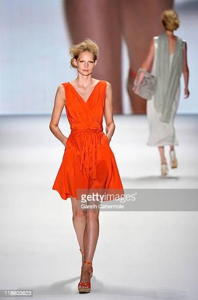 A model walks the runway at the Minx by Eva Lutz Show during MercedesBenz Fashion Week Berlin Spring/Summer 2012 at the Brandenburg Gate on July 9...
