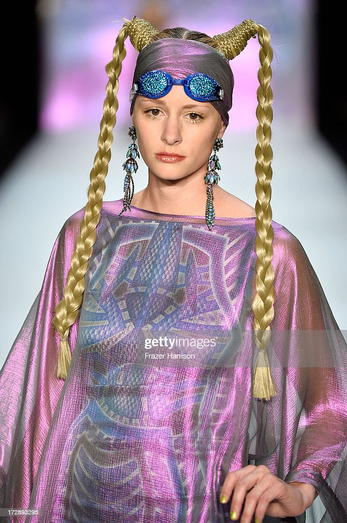 A model walks the runway at the Miranda Konstantinidou Show during the Mercedes-Benz Fashion Week Spring/Summer 2014 at Brandenburg Gate on July 5, 2013 in Berlin, Germany.