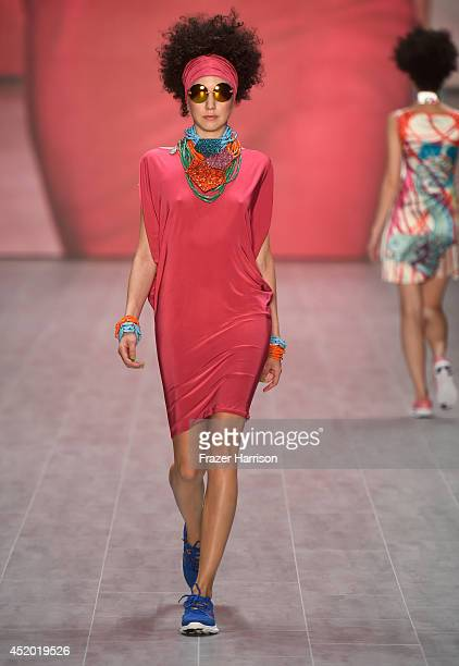 A model walks the runway at the Miranda Konstantinidou show during the MercedesBenz Fashion Week Spring/Summer 2015 at Erika Hess Eisstadion on July...