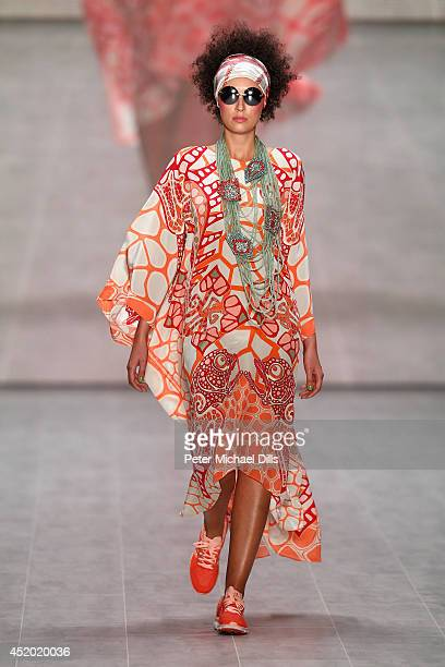 A model walks the runway at the Miranda Konstantinidou show during the MercedesBenz Fashion Week Spring/Summer 2015 at Erika Hess Eisstadion on July...