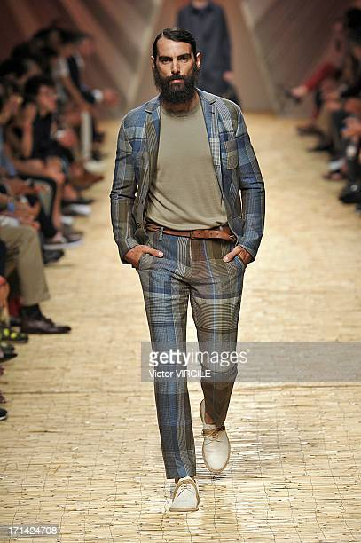A model walks the runway at the Missoni show during Milan Menswear Fashion Week Spring Summer 2014 on June 23 2013 in Milan Italy