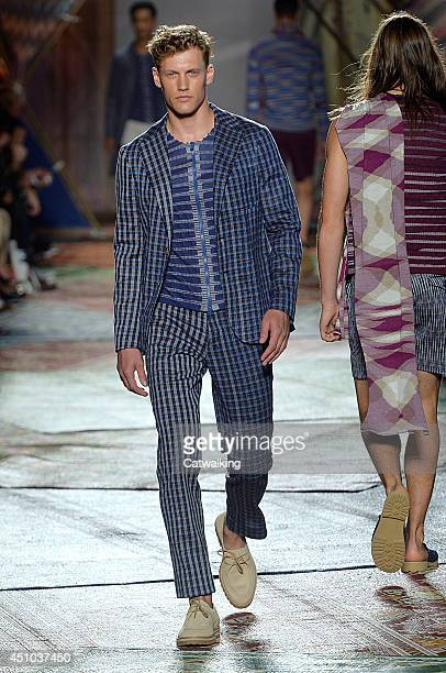 A model walks the runway at the Missoni Spring Summer 2015 fashion show during Milan Menswear Fashion Week on June 22 2014 in Milan Italy