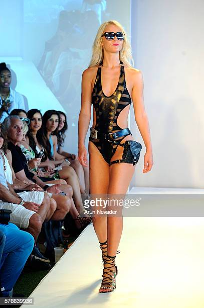 A model walks the runway at the Mister Triple X at the Art Hearts Fashion Miami Swim Week wearing Alejandra G shoes at W Hotel presented by Planet...