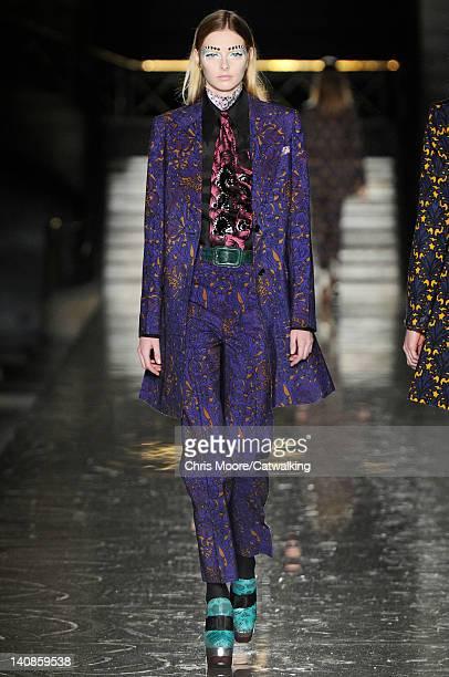 Model walks the runway at the Miu Miu Autumn Winter 2012 fashion show during Paris Fashion Week on March 7, 2012 in Paris, France.