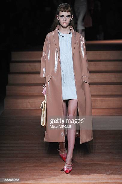 A model walks the runway at the Miu Miu Spring Summer 2013 fashion show during Paris Fashion Week on October 3 2012 in Paris France