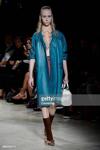 A model walks the runway at the Miu Miu Spring Summer 2015 fashion show during Paris Fashion Week on October 1 2014 in Paris France