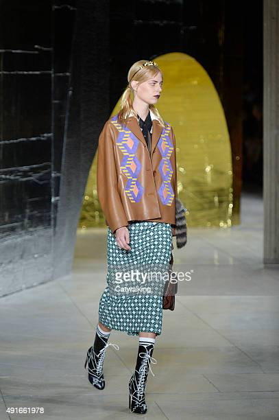 A model walks the runway at the Miu Miu Spring Summer 2016 fashion show during Paris Fashion Week on October 7 2015 in Paris France