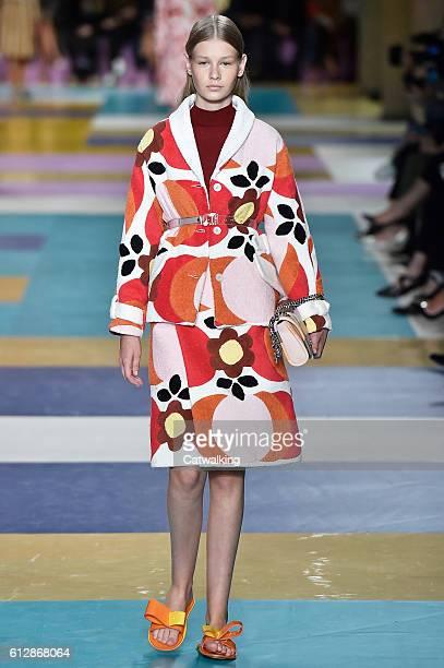 A model walks the runway at the Miu Miu Spring Summer 2017 fashion show during Paris Fashion Week on October 5 2016 in Paris France