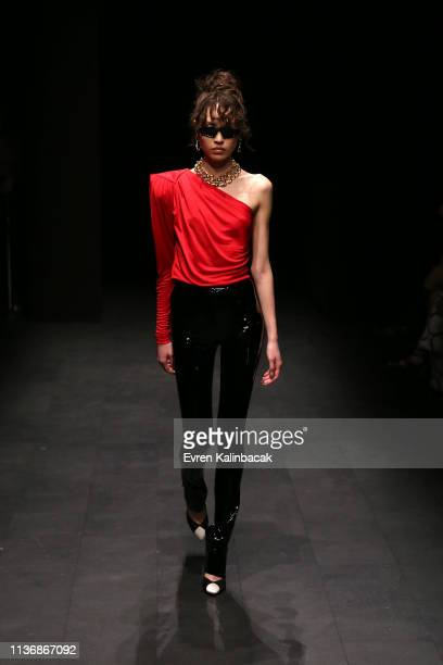 A model walks the runway at the MOFC Eda Gungor show during MercedesBenz Istanbul Fashion Week at the Zorlu Performance Hall on March 19 2019 in...