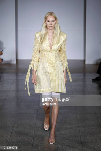A model walks the runway at the Moire show during Oslo Runway SS19 at Bankplassen 4 on August 15 2018 in Oslo Norway