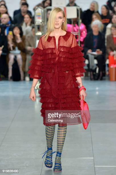 A model walks the runway at the Molly Goddard Autumn Winter 2018 fashion show during London Fashion Week on February 17 2018 in London United Kingdom