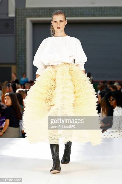 A model walks the runway at the Molly Goddard show during London Fashion Week September 2019 on September 14 2019 in London England