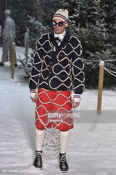 A model walks the runway at the Moncler Gamme Bleu Autumn Winter 2017 fashion show during Milan Menswear Fashion Week on January 15 2017 in Milan...