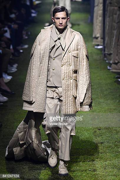 A model walks the runway at the Moncler Gamme Bleu show during Milan Men's Fashion Week Spring/Summer 2017 on June 19 2016 in Milan Italy