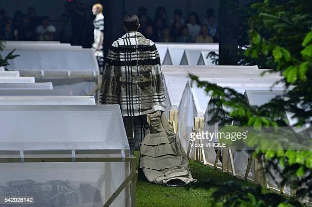 A model walks the runway at the Moncler Gamme Bleu show during Milan Men's Fashion Week Spring/Summer 2017 on June 19 2016 in Milan Italy