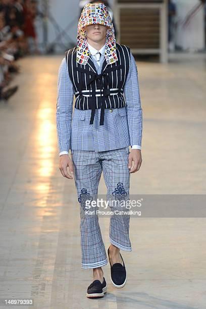 Model walks the runway at the Moncler Gamme Bleu Spring Summer 2013 fashion show during Milan Menswear Fashion Week on June 24, 2012 in Milan, Italy.