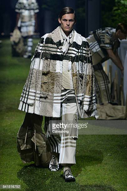 A model walks the runway at the Moncler Gamme Bleu Spring Summer 2017 fashion show during Milan Menswear Fashion Week on June 19 2016 in Milan Italy