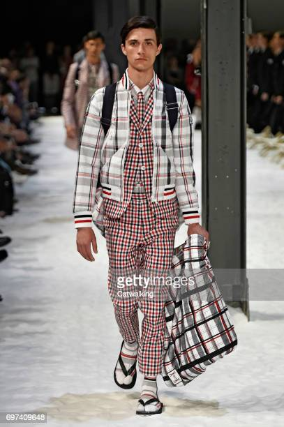 A model walks the runway at the Moncler Gamme Bleu Spring Summer 2018 fashion show during Milan Menswear Fashion Week on June 18 2017 in Milan Italy