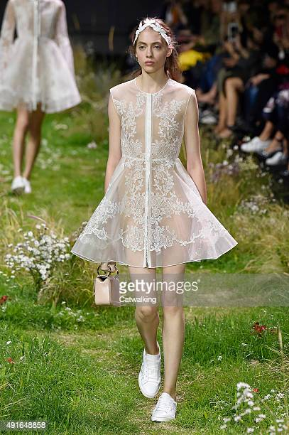 A model walks the runway at the Moncler Gamme Rouge Spring Summer 2016 fashion show during Paris Fashion Week on October 7 2015 in Paris France