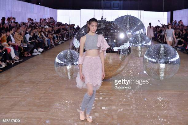 A model walks the runway at the Moncler Gamme Rouge Spring Summer 2018 fashion show during Paris Fashion Week on October 3 2017 in Paris France