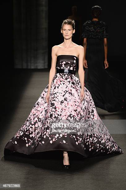 A model walks the runway at the Monique Lhuillier fashion show during MercedesBenz Fashion Week Fall 2014 at The Theatre at Lincoln Center on...