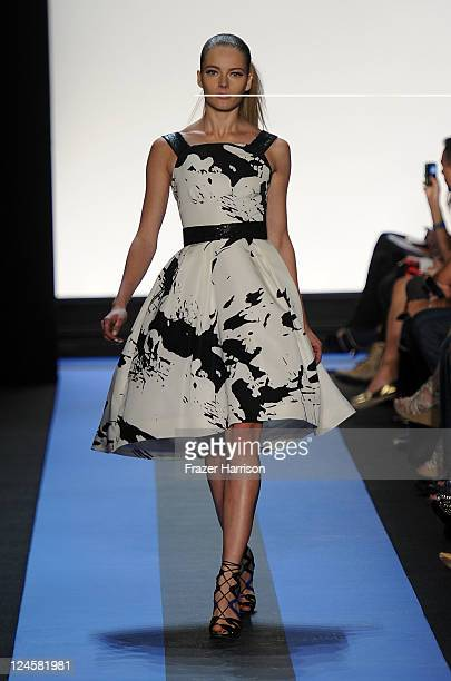 A model walks the runway at the Monique Lhuillier Spring 2012 fashion show during MercedesBenz Fashion Week at The Theater at Lincoln Center on...