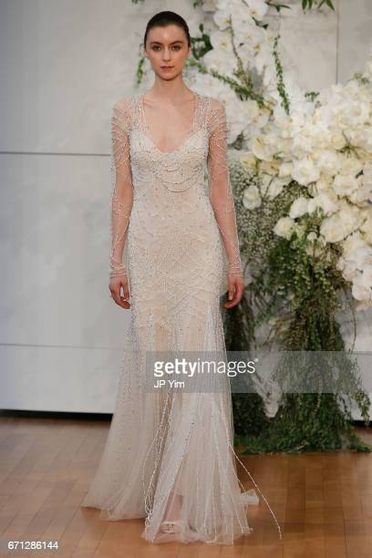 A model walks the runway at the Monique Lhuillier Spring 2018 Bridal show at Carnegie Hall on April 21 2017 in New York City