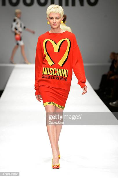 A model walks the runway at the Moschino Autumn Winter 2014 fashion show during Milan Fashion Week on February 20 2014 in Milan Italy