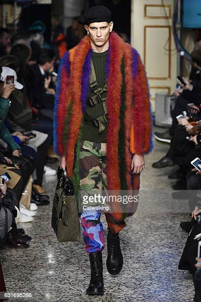 A model walks the runway at the Moschino Autumn Winter 2017 fashion show during Milan Menswear Fashion Week on January 14 2017 in Milan Italy
