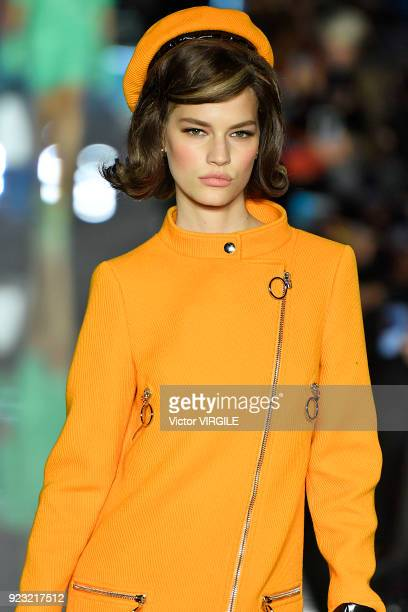 A model walks the runway at the Moschino Ready to Wear Fall/Winter 20182019 fashion show during Milan Fashion Week Fall/Winter 2018/19 on February 21...