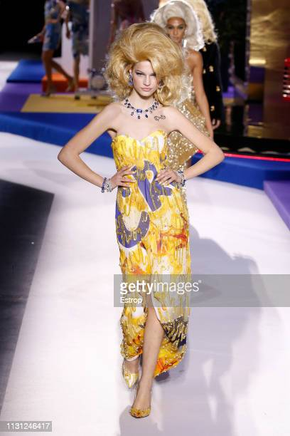 A model walks the runway at the Moschino show at Milan Fashion Week Autumn/Winter 2019/20 on February 20 2019 in Milan Italy