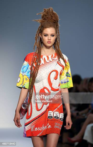 A model walks the runway at the Moschino show during the London Collections Men SS15 on June 16 2014 in London England