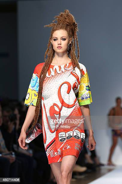 A model walks the runway at the Moschino show during the London Collections Men SS15 at Lindley Hall on June 16 2014 in London England