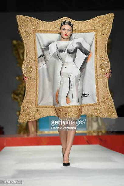 Model walks the runway at the Moschino show during the Milan Fashion Week Spring/Summer 2020 on September 19, 2019 in Milan, Italy.