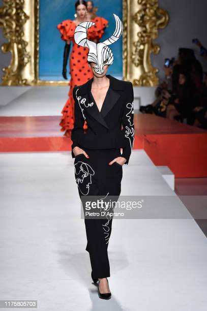 A model walks the runway at the Moschino show during the Milan Fashion Week Spring/Summer 2020 on September 19 2019 in Milan Italy