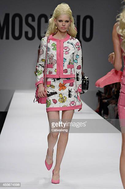 A model walks the runway at the Moschino Spring Summer 2015 fashion show during Milan Fashion Week on September 18 2014 in Milan Italy