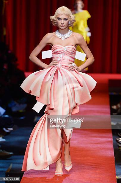 A model walks the runway at the Moschino Spring Summer 2017 fashion show during Milan Fashion Week on September 22 2016 in Milan Italy