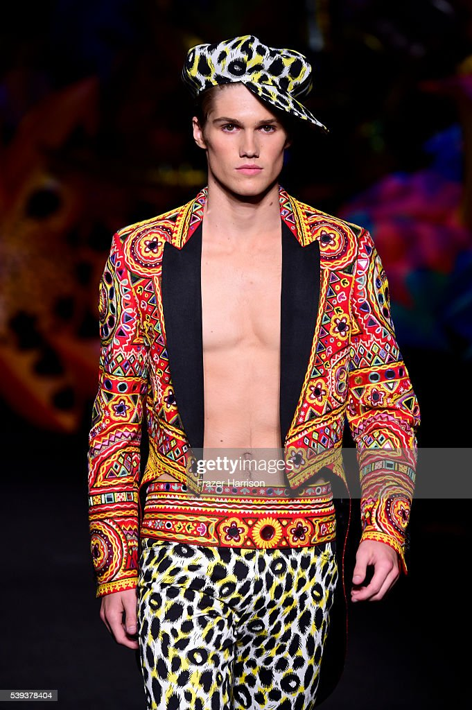 A model walks the runway at the Moschino Spring/Summer 17 Menswear and Women's Resort Collection during MADE LA at L.A. LIVE Event Deck on June 10, 2016 in Los Angeles, California.