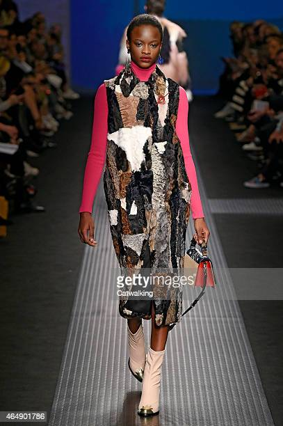 Model walks the runway at the MSGM Autumn Winter 2015 fashion show during Milan Fashion Week on March 1, 2015 in Milan, Italy.