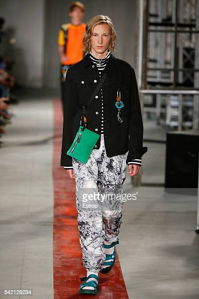 A model walks the runway at the MSGM show designed by Massimo Giorgetti during Milan Men's Fashion Week SS17 on June 20 2016 in Milan Italy