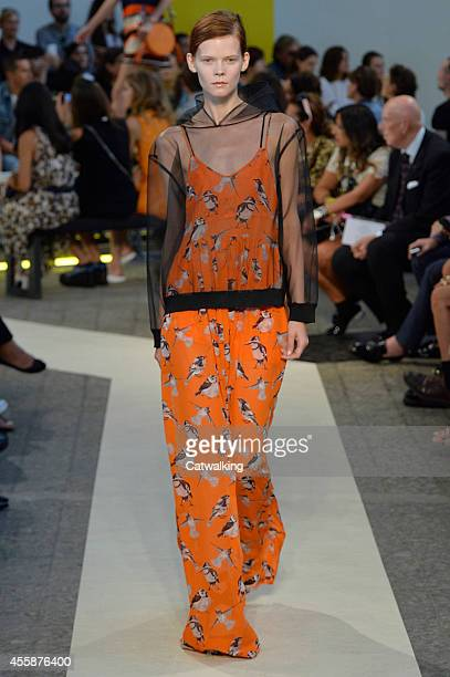 Model walks the runway at the MSGM Spring Summer 2015 fashion show during Milan Fashion Week on September 21, 2014 in Milan, Italy.