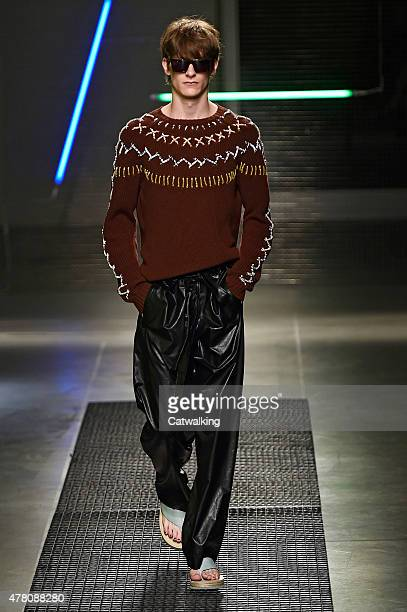 A model walks the runway at the MSGM Spring Summer 2016 fashion show during Milan Menswear Fashion Week on June 22 2015 in Milan Italy
