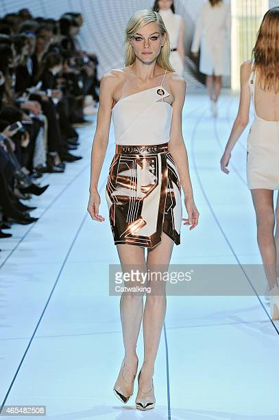 A model walks the runway at the Mugler Autumn Winter 2015 fashion show during Paris Fashion Week on March 7 2015 in Paris France
