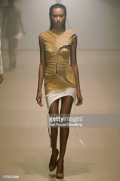 Model walks the runway at the Mugler Spring Summer 2012 fashion show during Paris Fashion Week on September 28, 2011 in Paris, France.