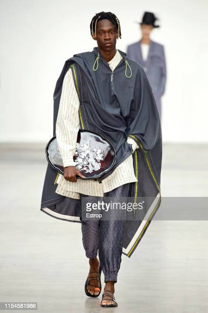 Model walks the runway at the Munn fashion show during London Fashion Week Men's June 2019 on June 8, 2019 in London, England.