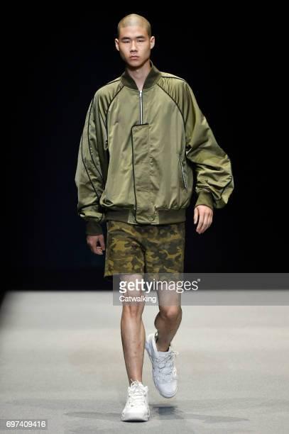 A model walks the runway at the Munsoo Kwon Spring Summer 2018 fashion show during Milan Menswear Fashion Week on June 18 2017 in Milan Italy